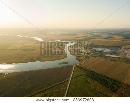 Aerial Drone View, At Sunset On The River Among The Fields. The Middle Band Of Russia.