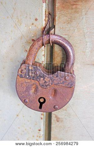 Old Rusty Closed Lock On The Door
