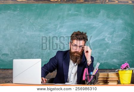 Teacher Formal Wear Sit Table Classroom Chalkboard Background. Teacher Concentrated Bearded Mature S