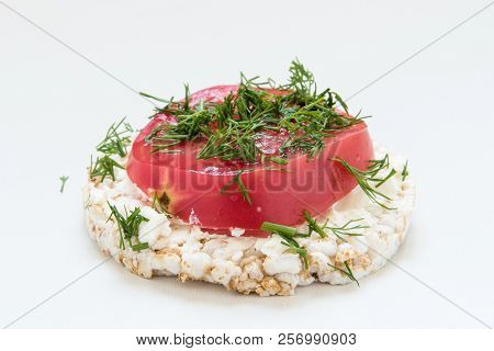 Round Crisp Breads With Cheese, Tomatoes, Dill And Avocado On White Background