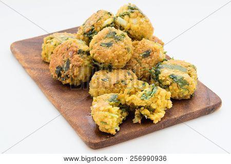 Fresh Vegetarian Falafel Balls On Cutting Board With Sauce