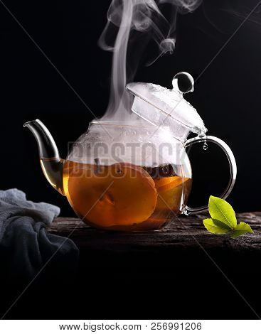 Green Tea With Apple Slices, Cinnamon And Steam