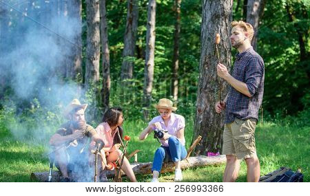 Tourists With Camera Relaxing Checking Photos. Company Having Hike Picnic Nature Background. Summer