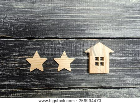 Two Stars And A House. Concept Of The Rating Of A Hotel Or Restaurant. Evaluation Of Real Estate, Cu