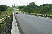 New roadbed and stormwater drainage. Stormwater drainage for drainage of rain water along the roadway. poster