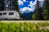 Family vacation travel, holiday trip in motorhome RV, Caravan car Vacation. Beautiful Nature Italy natural landscape Alps. poster