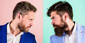 Business competition and confrontation. Business partners competitors or office colleagues in suits with tense bearded faces close up. Hostile or argumentative situation between opposing colleagues poster