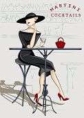 Beautiful stylish woman sitting at a cocktail bar poster