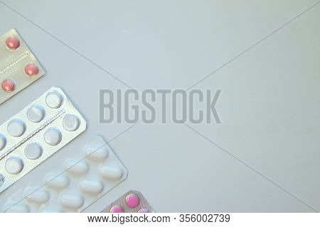 Background Of Pills And Thermometer. Global Healthcare Concept. Pandemic Virus Infection From Wuhan,