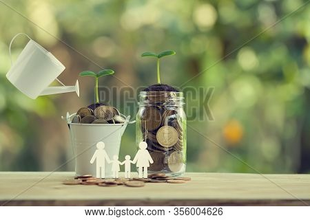 Banking And Finance, Saving Money Concept: Water Being Poured On Green Sprout With Glass Bottle And