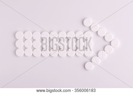 Arrow Made Of Round Pills. The Concept Of Direction In Medicine. Symbol Of Direction. Pills On A Whi