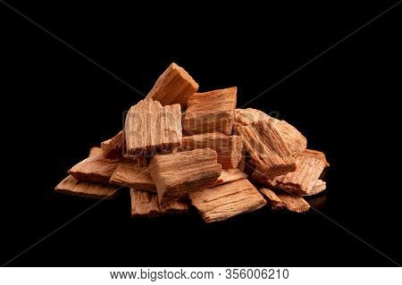 Chips Alder. Wood Chips. A Pile Of Small Slivers Of Alder On A Black Background. Chips For Smoking P