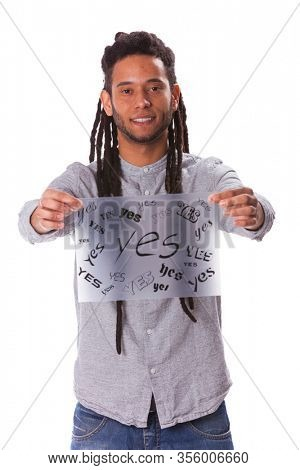 Rastafari men holding a acetate with lots YES words