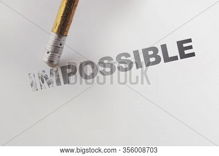 Changing The Word Impossible To Possible With A Pencil Eraser. Motivation Startup Concept