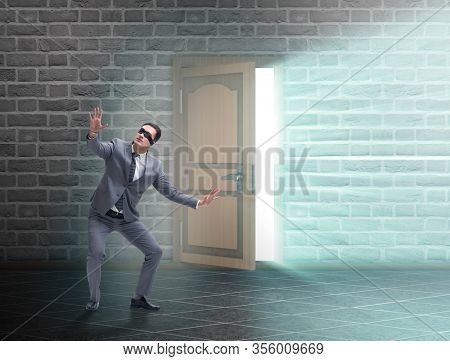 Businessman blindfold in uncertainty concept