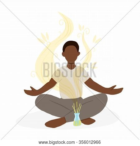 Young African American Man Sitting In Lotus Pose With Aroma Diffuser. Aromatherapy And Relax. Self C