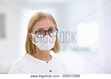 Senior Woman In Face Mask. Virus Outbreak.