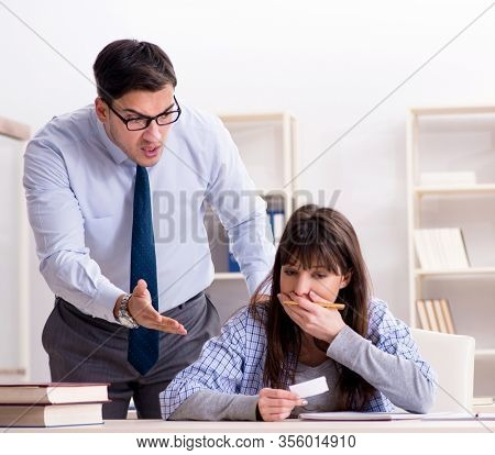 Male lecturer giving lecture to female student