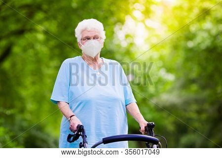 Senior Woman In Face Mask. Virus Outbreak.