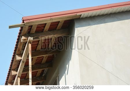 Close Up On Unfinished House Roof Soffit Boards Installation.