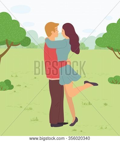 Happy Couple On Date In Park Or Forest. Man And Woman Hugging Standing Together. Love In Air, Romant