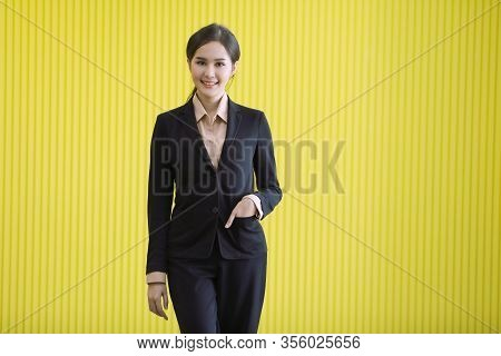 Close Up Portrait Shot Of Asian Businesswoman Standing, Smile And Put Hand In Suit Bag That Shows Th