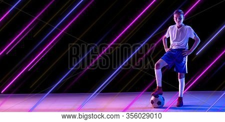 Creative Sport And Neon Lines On Dark Background, Flyer, Proposal. Male Soccer, Football Player Trai