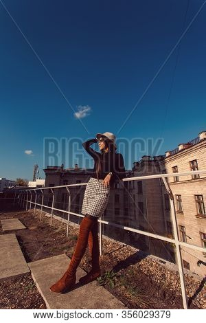 Fashion Woman Portrait Of Young Pretty Trendy Girl In Hat Posing At The City In Europe, Autumn Stree