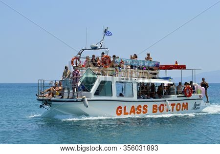 Anissaras, Crete, Greece - June 11, 2019 : Tourists On A Glass Bottom Boat In Anissaras A Tourist At