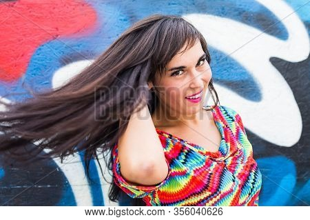 Summer And Joy Concept - Joyful Young Woman Flicking Her Hair Outdoors, Smiling And Feeling Joyful A