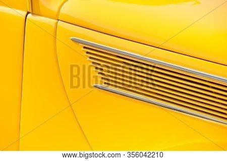 Golden Yellow Vintage Vehicle Door Panel Closeup