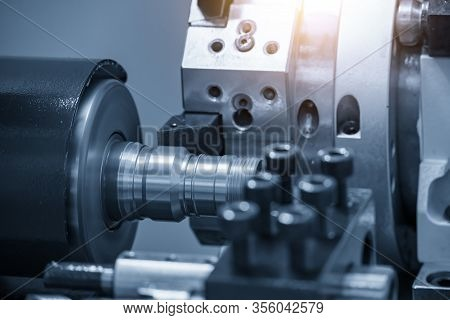 The Operation Of Cnc Lathe Machine Cutting The Pipeline Connector Parts With Lighting Effect. The Hi