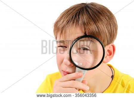 Curious Kid With Magnifying Glass Isolated On The White Background