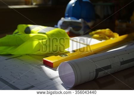 Construction Manager, Contractor, Builder Or Engineer Workplace With Tools And Building Sketch. Arch