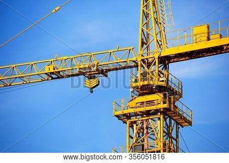 Crane. Self-erection Crane Against Blue Sky. Close Up.