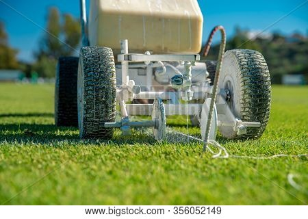 Lining A Football Pitch Using White Paint On Grass