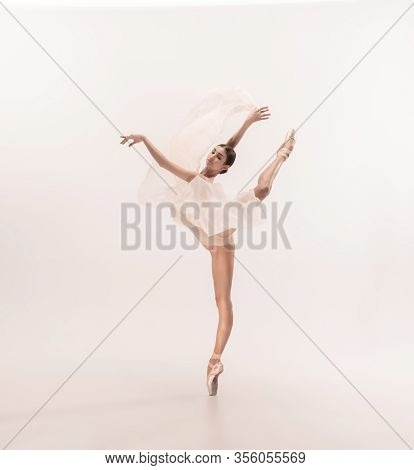 Graceful Classic Ballerina Dancing, Posing Isolated On White Studio Background. Tender Peach Cloth.