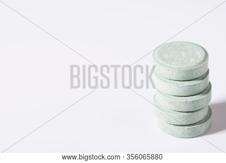Pill On A White Plate. A Pile Of Multi-colored Tablets Disguised As Food On A Plate With Cutlery On