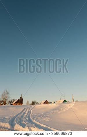 Winter Snowy Road To A Remote Village