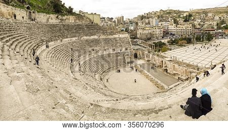 Amman, Jordan, March 2020: View From The Top Of The Roman Theatre, With Tourists Visiting And Wander