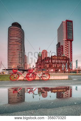 Rotterdam - 12 February 2019: Rotterdam, The Netherlands. Hotel New York. Two Red Bicycles Parked In