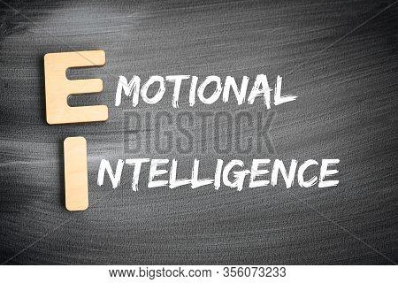 Ei - Emotional Intelligence Acronym, Business Concept On Blackboard