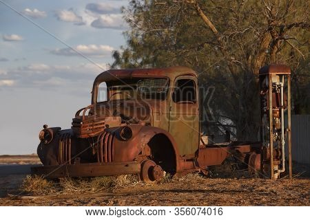 Abandoned Rusty Old Pick Up Truck Wreck Sits Derelict On The Side Of A Road On Sunset In The Austral