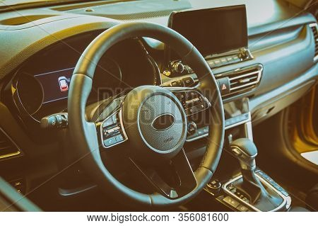 Modern Interior Of The Car, Steering Wheel And Dashboard, Multimedia System Of The Car With Navigati