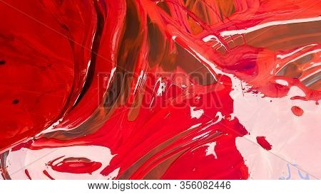 Abstract Background Of Spilled Red Paint With Buckets On A Black Backdrop. Red Paint Is Pouring On A