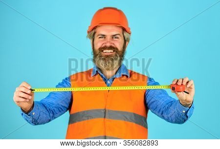 Safety Engineer Measure Acceptable Parameters. Builder With Tape Measure. Custom Made Furniture. Wor