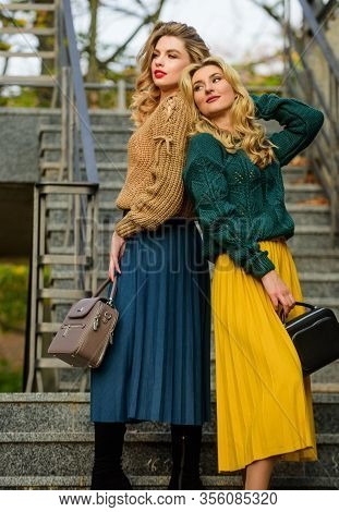 Confident In Style. Girls In Corrugated Skirt And Sweater. Female Beauty. Knitwear Fashion. Charm. S