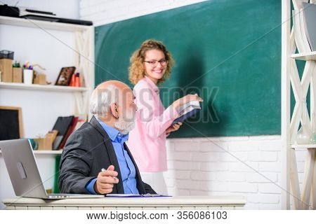Teacher And Student School Lesson. Regular School Lesson. Education Is Process Of Facilitating Learn
