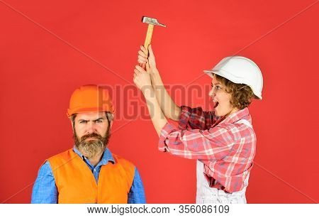 Couple Making Repair At Home. Home Renovation. Rub In. Couple Knocking Head With Hammer. Clearly Exp