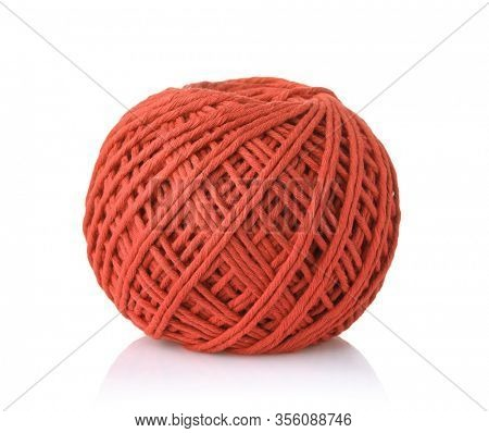 Clew of red cotton thread isolated on white